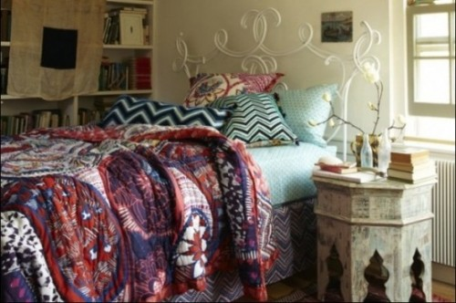 zascomfortable-boho-chic-bedroom-with-soft-blue-double-bed-and-unique-classic-night-table-also-beautiful-white-flowers-and-cool-white-book-shelves